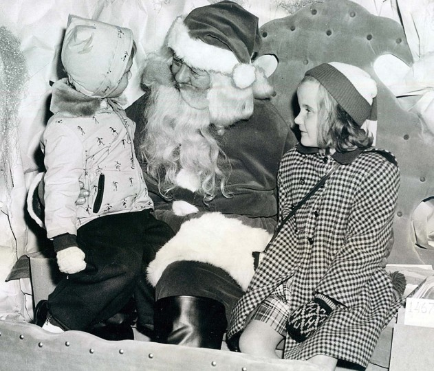 Patricia Ann Marvin and Carol Borig speak to Santa Claus in 1949. (Ralph Dohme/Baltimore Sun)