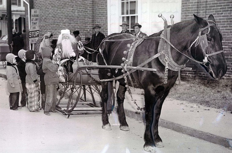 Donner and Blitzen wouldn't like this -- Santa Claus arrived at St Michaels, Md., in a sleigh. There was no snow and instead of reindeer, there was a horse to pull the sleigh with small wheels in 1952. (Ralph Dohme/Baltimore Sun)
