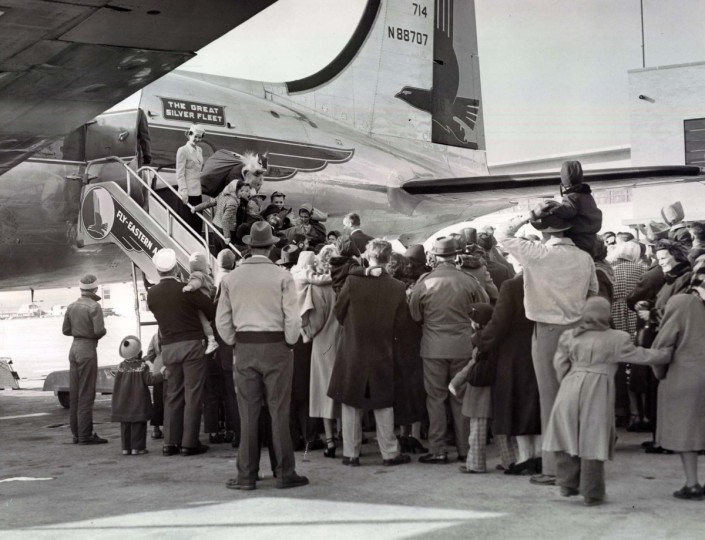 Santa arrives by plane at Friendship Airport and is greeted by a mob of kids in 1951.  (W. Ross Dunaway/Baltimore Sun)
