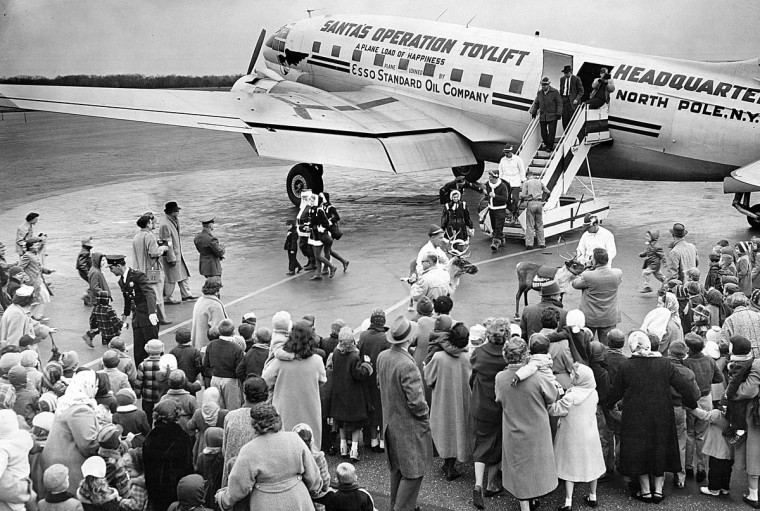 Santa arrives for a visit complete with reindeer and helpers during Operation Toylift at Friendship Airport in 1957. (Ellis Malashuk/Baltimore Sun)
