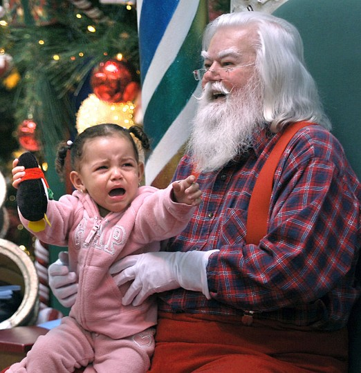 Nineteen-month-old Trinity Baker of Dundalk was less than pleased with the idea of posing with Santa Claus at White Marsh Mall in 2007. (Jed Kirschbaum/Baltimore Sun)
