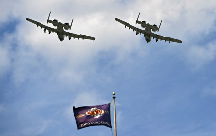 Baltimore, MD.--9/11/16-- Maryland Air National Guard A-10 Thunderbolts fly by M & T Bank Stadium after playing of the National Anthem before Ravens' 2016 season opener against the Bills. (Kenneth K. Lam/Baltimore Sun)