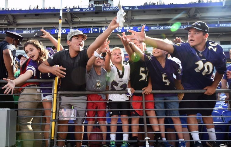 Baltimore, MD --9/11/16-- Young Ravens fans competes for game used glove tossed by Ravens players after defeating the Bills by score of 13 to 7 in their 2016 season opener at M & T Bank Stadium. (Kenneth K. Lam/Baltimore Sun)