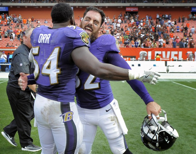 Cleveland, OH --9/18/16-- Ravens' Eric Weddle, right, celebrates with teammate Zachary Orr after defeating the Browns' by score of 25 to 20 at First Energy Stadium. (Kenneth K. Lam/Baltimore Sun)