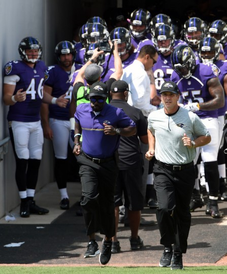 Jacksonville, FL --9/25/16-- Ravens head coach John Harbaugh leads his team onto Ever Bank Field before game against  the Jaguars. (Kenneth K. Lam/Baltimore Sun)