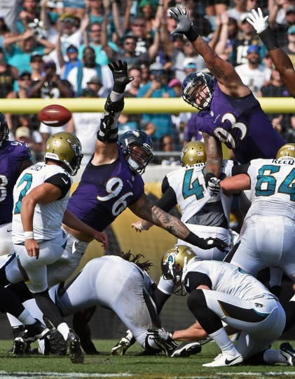 Jacksonville, FL --9/25/16-- Ravens' Brent Urban (#96), center, blocks a 52-yards field goal attempt by Jaguars kicker Jason Myers (#2) in the fourth quarter. The Ravens defeated the Jaguars by score of 19 to 17 at Ever Bank Field. (Kenneth K. Lam/Baltimore Sun)