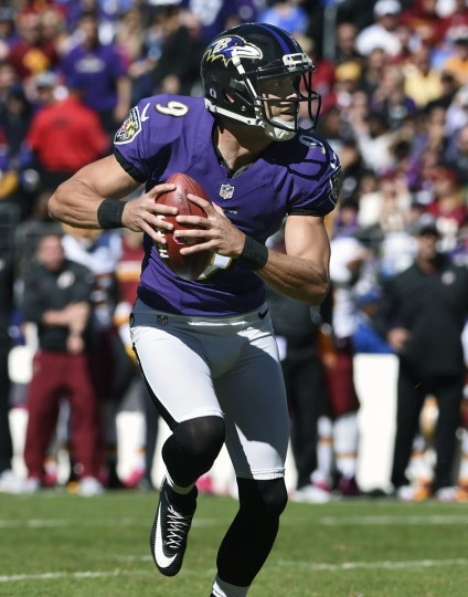 Baltimore, MD --10/9/16-- Ravens kicker Justin Tucker looks for a teammate to throw the ball to during a fake field goal attempt against the Redskins at M & T Bank Stadium. (Kenneth K. Lam/Baltimore Sun)