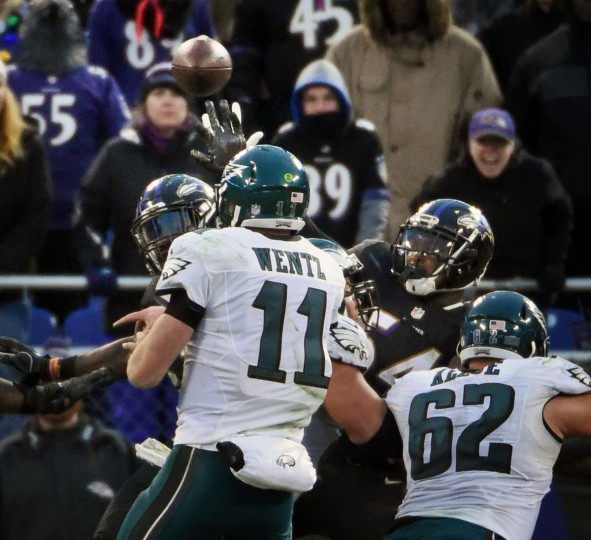 Baltimore, Md.--12/18/16-- Eagles quarterback Carson Wentz's (#11) throw was tipped at the line of scrimmage by Ravens' C. J. Mosley, left, on a two-point conversion attempt in the fourth quarter. The Ravens defeated the Eagles by score of 27 to 26 at M & T Bank Stadium.(Kenneth K. Lam/Baltimore Sun)