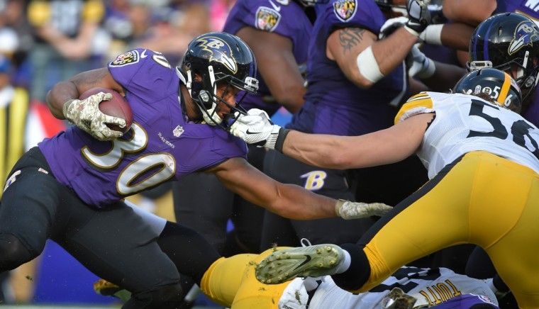Baltimore, Maryland--11/6/16-- Steelers' #56 Anthony Chickillo is called for a facemask penalty on Ravens' #30 Kenneth Dixon in the second quarter at M&T Bank Stadium.  (Lloyd Fox/Baltimore Sun)