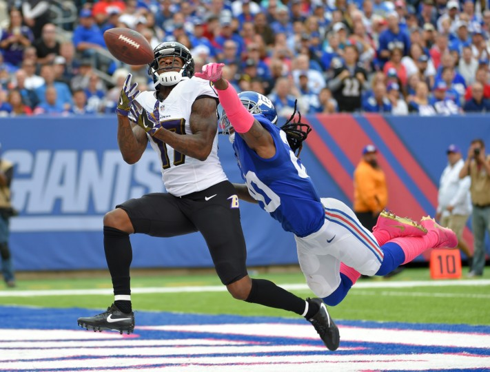 East Rutherford, NJ---10/16/16-- Ravens' #17 Mike Wallace nearly catches a third quarter touchdown pass as he is defended by Giants' #20 Janoris Jenkins at MetLife Stadium.   (Lloyd Fox/Baltimore Sun)
