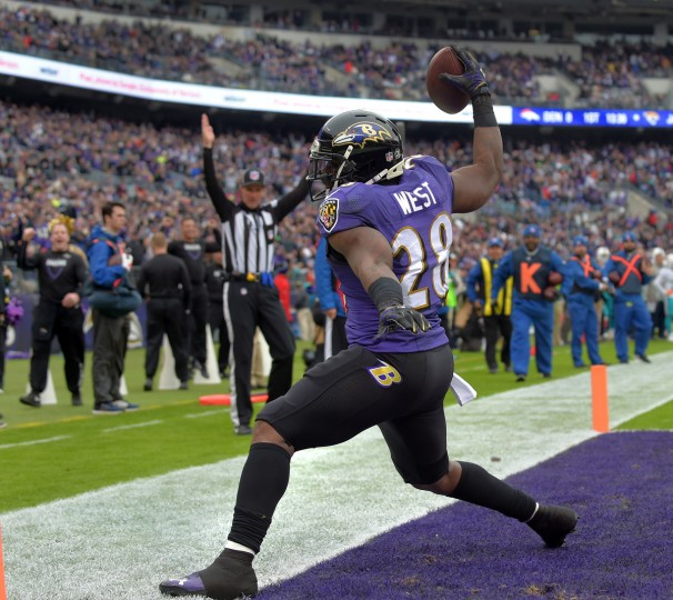 Baltimore, Maryland--12/4/16-- Ravens' #28 Terrance West celebrates his first quarter touchdown against the Miami Dolphins at M&T Bank Stadium.   (Lloyd Fox/Baltimore Sun)