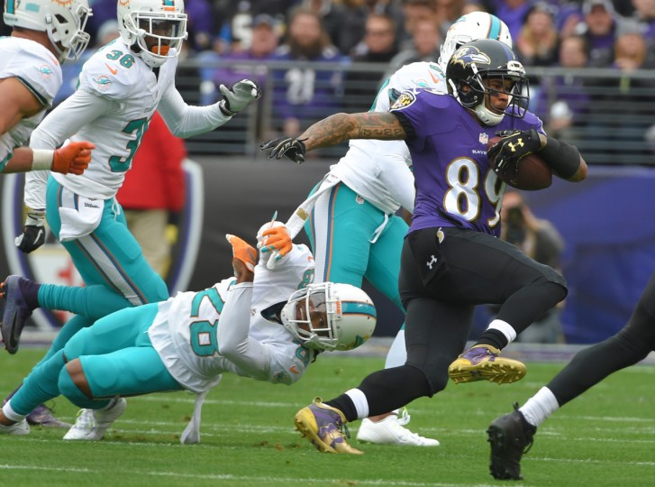 Baltimore, Maryland--12/4/16-- Ravens' #89 Steve Smith Sr. runs for a first down after a first quarter reception.  Dolphins' #28 Bobby McCain couldn't make the tackle at M&T Bank Stadium.   (Lloyd Fox/Baltimore Sun)