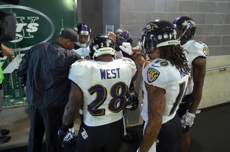 East Rutherford, NJ---10/16/16-- Baltimore Ravens' offense gathers before making their way to the field before the game against the New York Giants at MetLife Stadium.   (Lloyd Fox/Baltimore Sun)