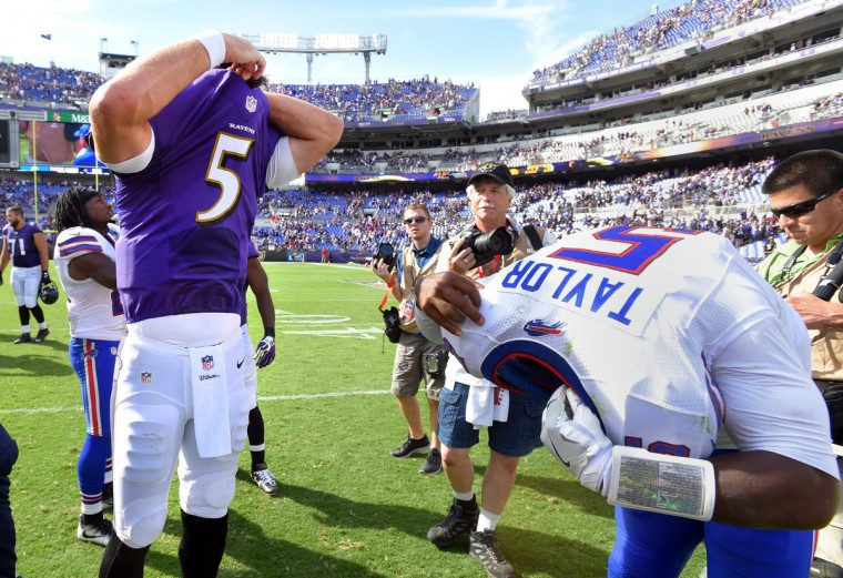 Baltimore, MD---9/11/16--  Ravens' quarterback #5 Joe Flacco and Bill's quarterback #5 Tyrod Taylor take off their jerseys to exchange after the game.   (Lloyd Fox/Baltimore Sun)