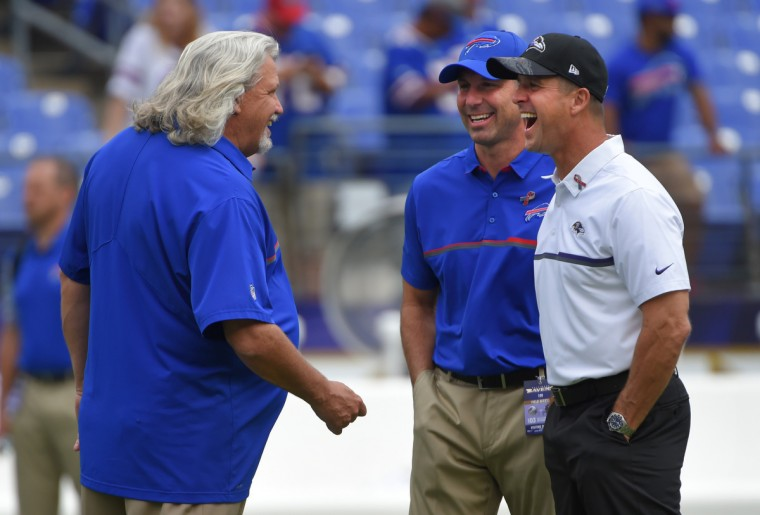 Baltimore, MD---9/11/16--Ravens head coach John Harbaugh (R) meets with Buffalo Bills coaches, Rob Ryan (L) and Danny Crossman (M) before the game.  (Lloyd Fox/Baltimore Sun)