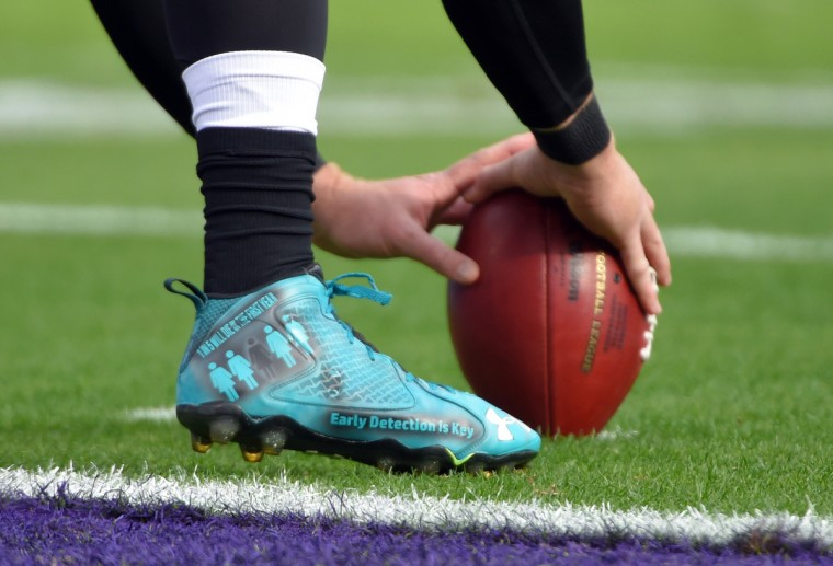 Baltimore, Maryland--12/4/16-- Shoes worn by Ravens'  #46 Morgan Cox are seen before the Ravens took on the Dolphins at M&T Bank Stadium.  Players were allowed to wear personal notes on their shoes today.  (Lloyd Fox/Baltimore Sun)
