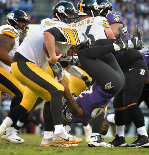 Baltimore, Maryland--11/6/16-- Ravens' #26 Jerraud Powers sacks Steelers quarterback #7 Ben Rothlisberger in the 4th quarter at M&T Bank Stadium.   (Lloyd Fox/Baltimore Sun)