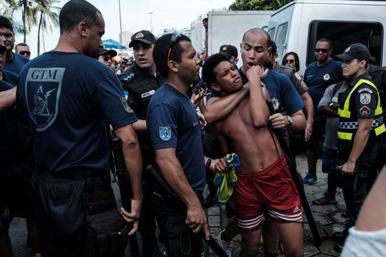 A snatcher is arrested by police officers during the 21st Rio LGBT pride parade at Copacabana beach in Rio de Janeiro, Brazil, on December 11, 2016. (YASUYOSHI CHIBA/AFP/Getty Images)