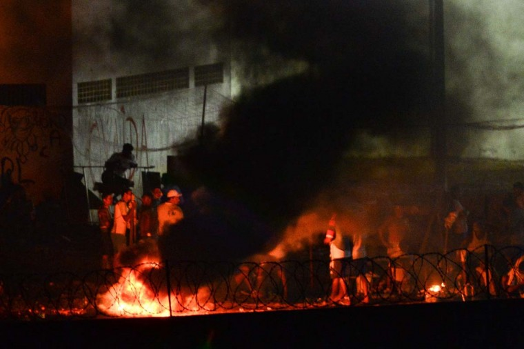 Prisoners were arrested after setting fire during a riot at the Alcacuz Penitentiary Center near Natal in Rio Grande do Norte, Brazil on January 17, 2017. Brazilian police fired rubber bullets Tuesday at inmates who have taken over a jail where dozens were massacred over the weekend in the latest in a string of prison riots. Police positioned on top of the outer walls of the Alcacuz jail near the northeastern city of Natal fired at a crowd of inmates who had taken control of part of the complex. A total of 26 prisoners were killed in Alcacuz -- many of them beheaded -- during a violent riot that broke out late Saturday, according to officials. (ANDRESSA ANHOLETE/AFP/Getty Images)