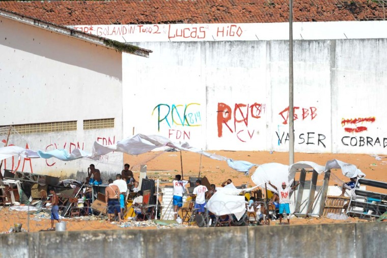 Prisoners during a riot at the Alcacuz Penitentiary Center near Natal in Rio Grande do Norte, Brazil on January 17, 2017. Brazilian police fired rubber bullets Tuesday at inmates who have taken over a jail where dozens were massacred over the weekend in the latest in a string of prison riots. Police positioned on top of the outer walls of the Alcacuz jail near the northeastern city of Natal fired at a crowd of inmates who had taken control of part of the complex. A total of 26 prisoners were killed in Alcacuz -- many of them beheaded -- during a violent riot that broke out late Saturday, according to officials. (ANDRESSA ANHOLETE/AFP/Getty Images)