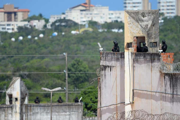 "Members of the special police battalion are seen at the Alcacuz Penitentiary Center where they entered to regain control of the penitentiary in Rio Grande do Norte, Brazil, on January 18, 2017. Brazilian authorities said Wednesday they are deploying 1,000 troops to ""clean out"" arms and cellphones from restive prisons while police struggled to end a deadly gang face-off at Alcacuz. The soldiers were being brought in to respond to a ""national emergency"" in the badly overcrowded prison system, Defense Minister Raul Jungmann said. (ANDRESSA ANHOLETE/AFP/Getty Images)"