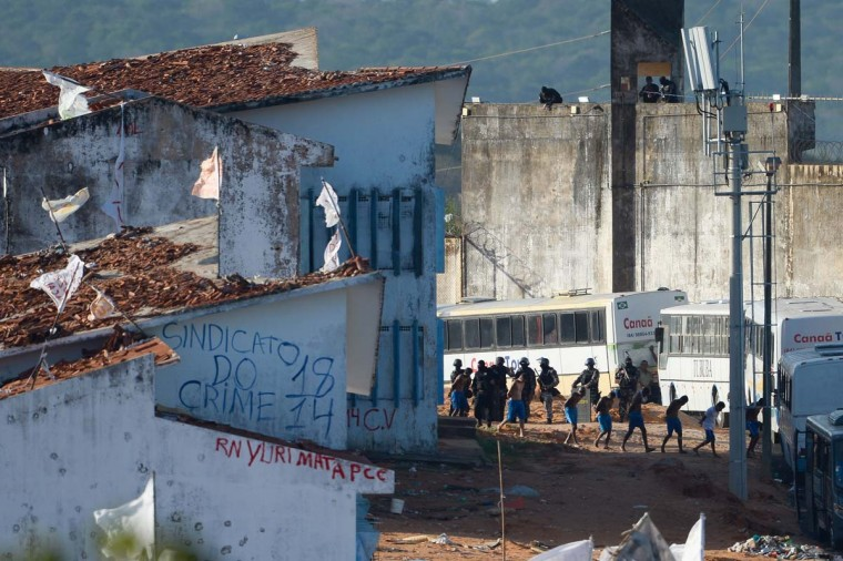 "Some 200 prisoners are embarked on buses to be transferred from the Alcacuz Penitentiary Center to other prisons in Rio Grande do Norte, Brazil on January 18, 2017. Brazilian authorities said Wednesday they are deploying 1,000 troops to ""clean out"" arms and cellphones from restive prisons while police moved to end a deadly gang face-off in one northern penitentiary. (ANDRESSA ANHOLETE/AFP/Getty Images)"