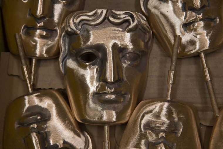 Polished BAFTA (British Academy of Film and Television Arts) masks sit in a box during a photocall at the New Pro Foundries, west of London on January 31, 2017. The masks will be presented to winners at BAFTA's awards ceremony in London on February 12, 2017. (DANIEL LEAL-OLIVAS/AFP/Getty Images)