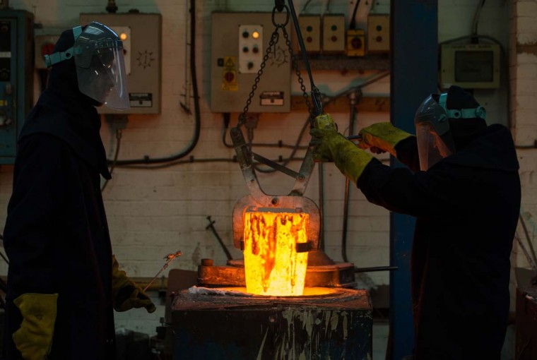 Workers prepare molten bronze before casting BAFTA (British Academy of Film and Television Arts) masks during a photocall at the New Pro Foundries, west of London on January 31, 2017. The masks will be presented to winners at BAFTA's awards ceremony in London on February 12, 2017. (DANIEL LEAL-OLIVAS/AFP/Getty Images)