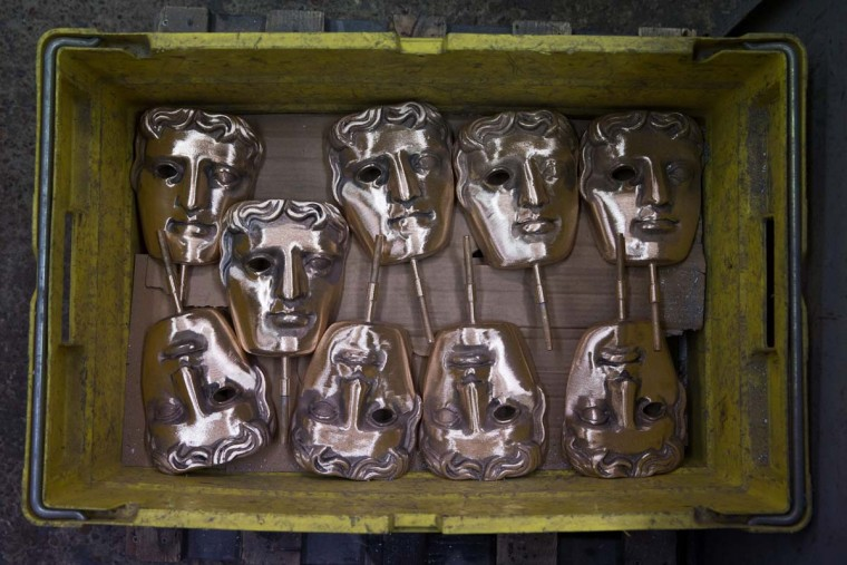 Freshly-cast BAFTA (British Academy of Film and Television Arts) masks sit in a box during a photocall at the New Pro Foundries, west of London on January 31, 2017. The masks will be presented to winners at BAFTA's awards ceremony in London on February 12, 2017. (DANIEL LEAL-OLIVAS/AFP/Getty Images)