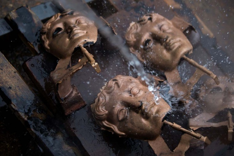 BAFTA (British Academy of Film and Television Arts) masks are cooled down with water after being cast during a photocall at the New Pro Foundries, west of London on January 31, 2017. The masks will be presented to winners at BAFTA's awards ceremony in London on February 12, 2017. (DANIEL LEAL-OLIVAS/AFP/Getty Images)