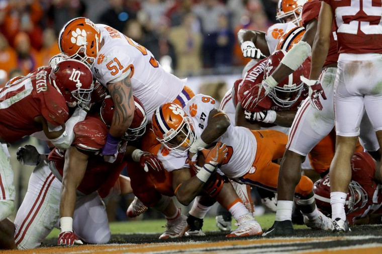 Running back Wayne Gallman #9 of the Clemson Tigers rushes for a 1-yard touchdown during the fourth quarter against the Alabama Crimson Tide in the 2017 College Football Playoff National Championship Game at Raymond James Stadium on January 9, 2017 in Tampa, Florida. (Photo by Ronald Martinez/Getty Images)