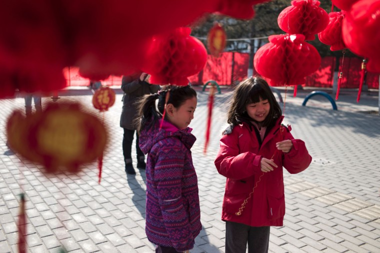 Chinese children stand near a lantern tree display ahead of the Lunar New Year in Beijing on January 24, 2017. The Lunar New Year, known locally as the Spring Festival, falls on January 28 this year and marks the Year of the Rooster in the Chinese calendar. (Fred Dufour/AFP/Getty Images)