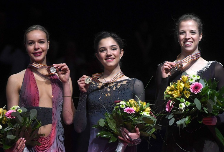 (L to R) Second placed Russia's Anna Pogorilaya, winner Russia's Evgenia Medvedeva and third placed Italy's Carolina Kostner pose with their medals on the podium of the ladies free skating competition of the European Figure Skating Championship in Ostrava, Czech Republic on January 27, 2017. (Michal Cizek/AFP/Getty Images)