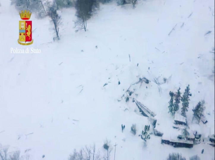 This image grab made from a video handout released by the Polizia di Stato on January 19, 2017 shows an aerial view of the Hotel Rigopiano, near the village of Farinfola, on the eastern lower slopes of the Gran Sasso mountain, engulfed by a powerful avalanche. Up to 30 people were feared to have died after an Italian mountain Hotel Rigopiano was engulfed by a powerful avalanche in the earthquake-ravaged center of the country. Italy's Civil Protection agency confirmed the Hotel Rigopiano had been engulfed by a six-feet high wall of snow and that emergency services were struggling to get ambulances and diggers to the site. (AFP PHOTO / Polizia di Stato / Handout)