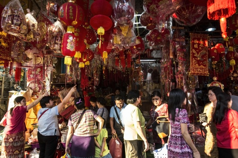 People walk past lanterns and decorations at a market ahead of the Chinese Lunar New Year in Yangon's Chinatown district on January 24, 2017. (Ye Aung Thu/AFP/Getty Images)