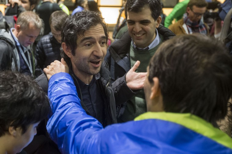 BOSTON, MA - JANUARY 28: Mazdak Tootkaboni is welcomed during a demonstration against the new ban on immigration issued by President Donald Trump at Logan International Airport on January 28, 2017 in Boston, Massachusetts. Tootkaboni is a U.S. green card holder from Iran and a professor at the University of Massachusetts at Dartmouth, but he was still separated from other passengers and questioned as a result of the new immigration ban issued by President Donald Trump. President Trump signed an executive order that halted refugees and residents from predominantly Muslim countries from entering the United States. (Photo by Scott Eisen/Getty Images)