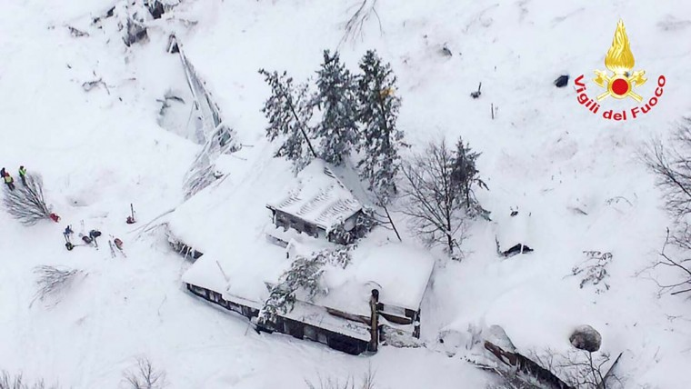 This handout image obtained on the Vigili del Fuoco twitter account on January 19, 2017 shows an aerial view of the Hotel Rigopiano, near the village of Farindola, on the eastern lower slopes of the Gran Sasso mountain, engulfed by a powerful avalanche. Up to 30 people were feared to have died after an Italian mountain Hotel Rigopiano was engulfed by a powerful avalanche in the earthquake-ravaged center of the country. Italy's Civil Protection agency confirmed the Hotel Rigopiano had been engulfed by a (six-feet) high wall of snow and that emergency services were struggling to get ambulances and diggers to the site. (AFP PHOTO / Vigili del Fuoco / Handout)
