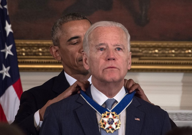 U.S. President Barack Obama awards Vice President Joe Biden the Presidential Medal of Freedom during a tribute to Biden at the White House in Washington, DC, on January 12, 2017. (Nicholas Kamm/AFP/Getty Images)