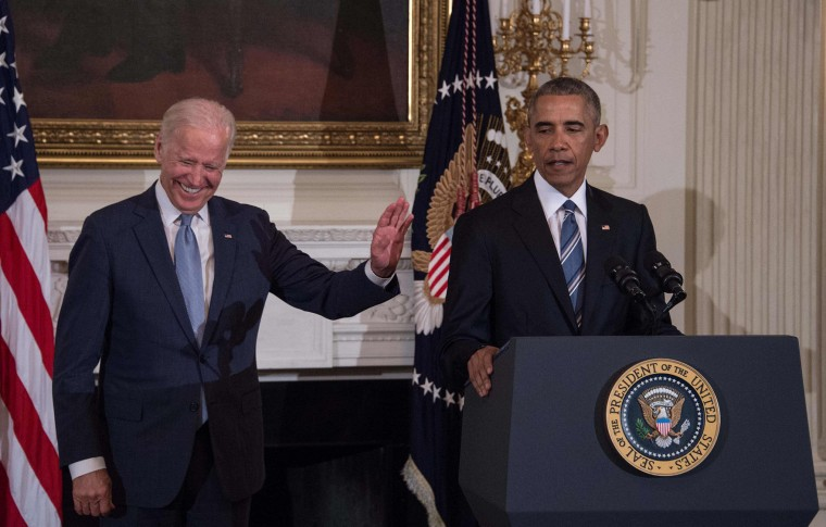 U.S. Vice President Joe Biden gestures as President Barack Obama speaks during a tribute to Biden at the White House in Washington, DC, on January 12, 2017. (Nicholas Kamm/AFP/Getty Images)