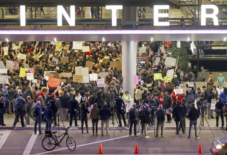 Hundreds of people opposed to President Donald Trump's executive orders barring entry to the U.S. of seven predominantly Muslim countries demonstrate at the Tom Bradley International Terminal at Los Angeles International Airport Saturday, Jan. 28, 2017. (AP Photo/Reed Saxon)