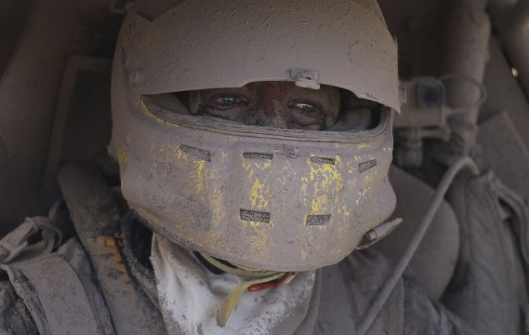 Suzuki car driver Tim Coronel of the Netherlands is covered in dirt after completing the second stage of the Dakar Rally on Jan. 3, 2017. The race started in Paraguay and will pass through Bolivia as well. (Martin Mejia/AP)