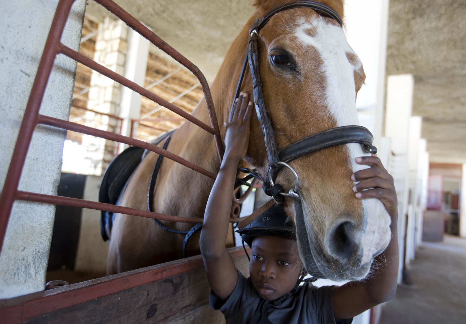 Horse riding improves life for disabled Haiti boy