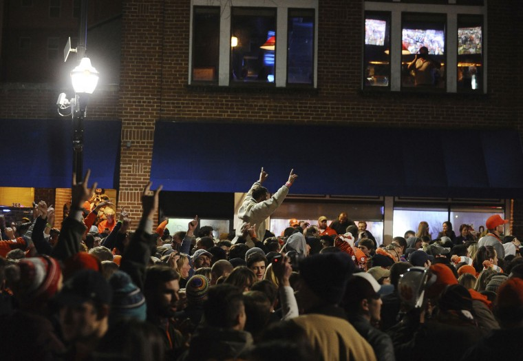Clemson fans celebrate in the street after Clemson defeated Alabama 35-31 in the NCAA college football playoff championship game, Tuesday, Jan. 10, 2017, in Clemson, S.C. (AP Photo/Rainier Ehrhardt)