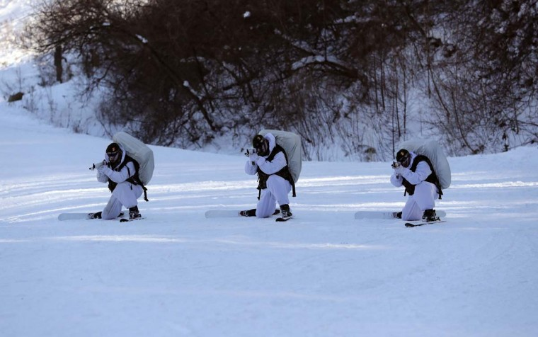 South Korean Marines partake in a combined military winter exercise with U.S. Marines in Pyeongchang, South Korea, Tuesday, Jan. 24, 2017. Marines from South Korea and the U.S. are participating in the four-week winter combined exercise in South Korea. (AP Photo/Lee Jin-man)