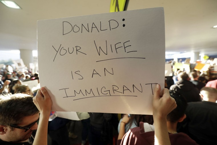 A protester holds a sign at San Francisco International Airport during a demonstration to denounce President Donald Trump's executive order that bars citizens of seven predominantly Muslim countries from entering the U.S. Saturday, Jan. 28, 2017, in San Francisco. (AP Photo/Marcio Jose Sanchez)