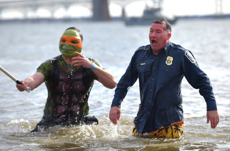 Michael Heup and Cpt. Francis Tewey of the Anne Arundel County Police Department in the 40-degree water during their plunge. (Lloyd Fox/Baltimore Sun)