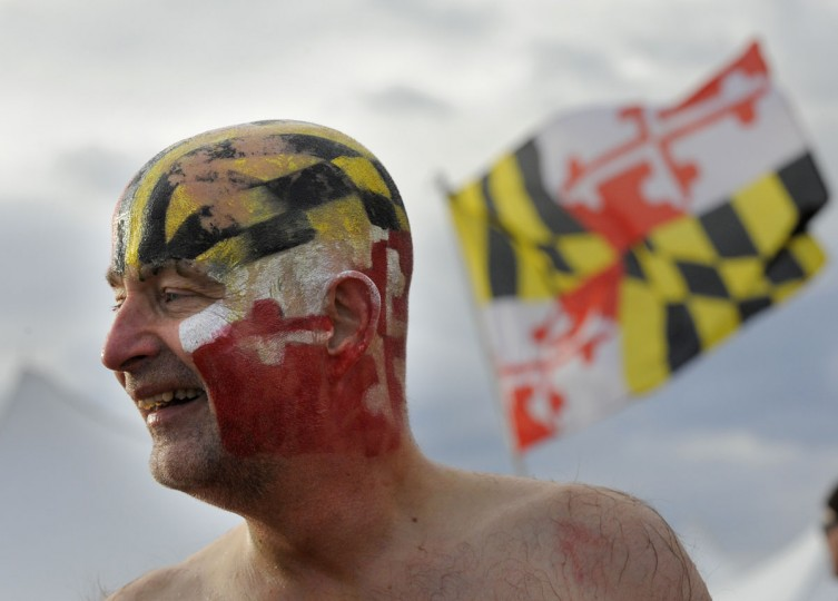 Paul Czajkowski of Linthicum with what's left of the Maryland colors painted on his head after the Corporate Plunge. (Lloyd Fox/Baltimore Sun)