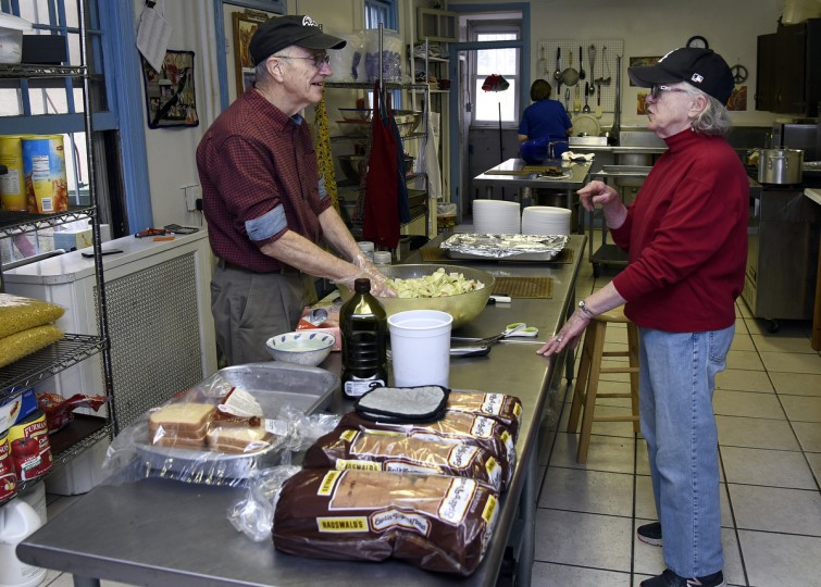 Brother Tom Trager, left, a volunteer, talks with Willa Bickham, right, in the kitchen at Viva House, a West Baltimore soup kitchen that was founded 49 years ago by Ms. Bickham and her husband Brendan Walsh.  They are part of hte Catholic Worker movement. (Barbara Haddock Taylor/Baltimore Sun)