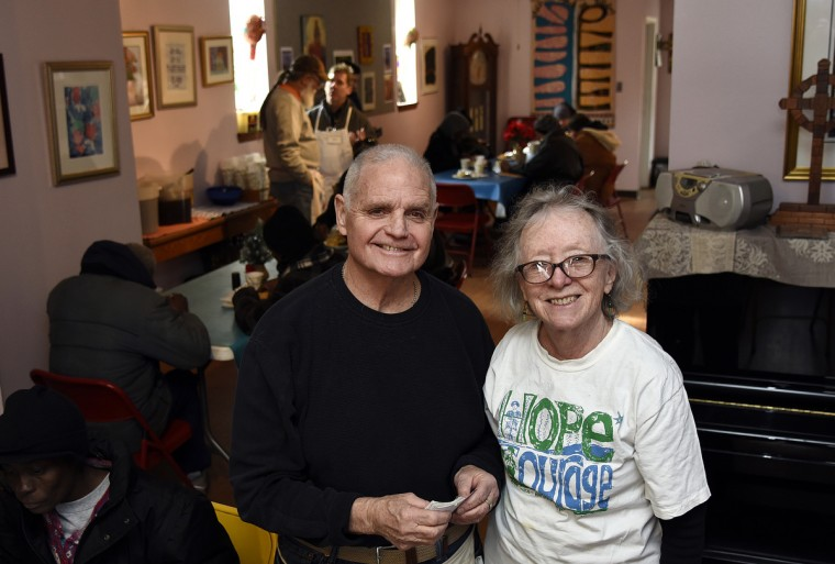 Brendan Walsh, left, and his wife Willa Bickham, right, stand in one of the dining rooms at Viva House, a West Baltimore soup kitchen they founded 49 years ago. They are part of the Catholic Worker movement. (Barbara Haddock Taylor/Baltimore Sun)