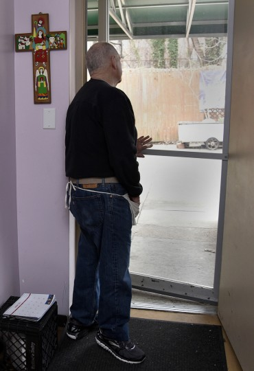 Brendan Walsh looks into the yard from a door at Viva House, a West Baltimore soup kitchen that was founded 49 years ago by he and his wife Willa Bickham, who are part of the Catholic Worker movement.   (Barbara Haddock Taylor/Baltimore Sun)